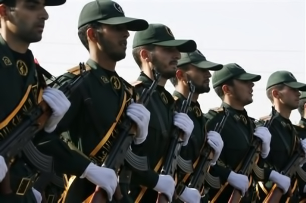 FILE - In this Sunday, Sept. 21, 2008 file photo, Iranian Revolutionary Guards members march during a parade ceremony, marking the 28th anniversary of the onset of the Iran-Iraq war (1980-1988), in front of the mausoleum of the late revolutionary founder Ayatollah Ruhollah Khomeini, just outside Tehran, Iran. Iran's elite Revolutionary Guard, aided by an affiliated volunteer militia, the Basij, is using the post-election turmoil to tighten its already powerful hold over the country, raising alarm among some Iranians that it is transforming the Islamic Republic into a military state. (AP Photo/Vahid Salemi, File)